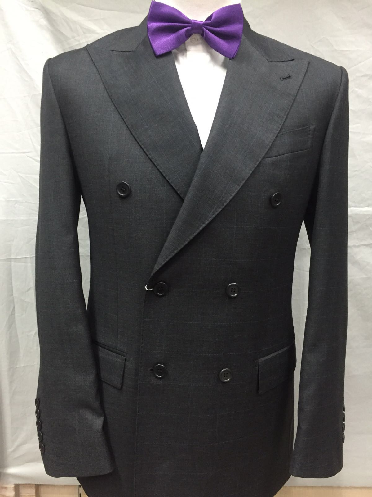 Grey double breasted Cerrutti wool suit with large peak lapel.